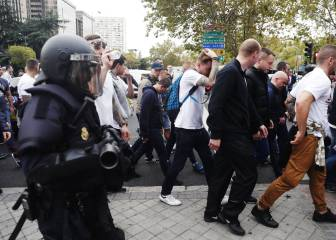 Police and Legia ultras battle outside the Bernabéu