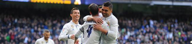 Sergio Ramos of Real Madrid celebrates with Henrique Casemiro after scoring his team's 1st goal during the La Liga match between Real Madrid CF and Malaga CF at the Bernabeu on January 21, 2017 in Madrid, Spain.