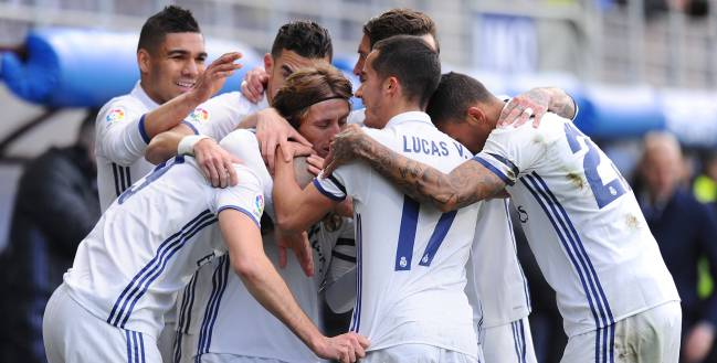 Karim Benzema (#9) of Real Madrid celebrates with teammates after scoring Real's 1st goal during the La Liga match between SD Eibar and Real Madrid CF at Estadio Municipal de Ipurua on March 4, 2017 in Eibar, Spain.