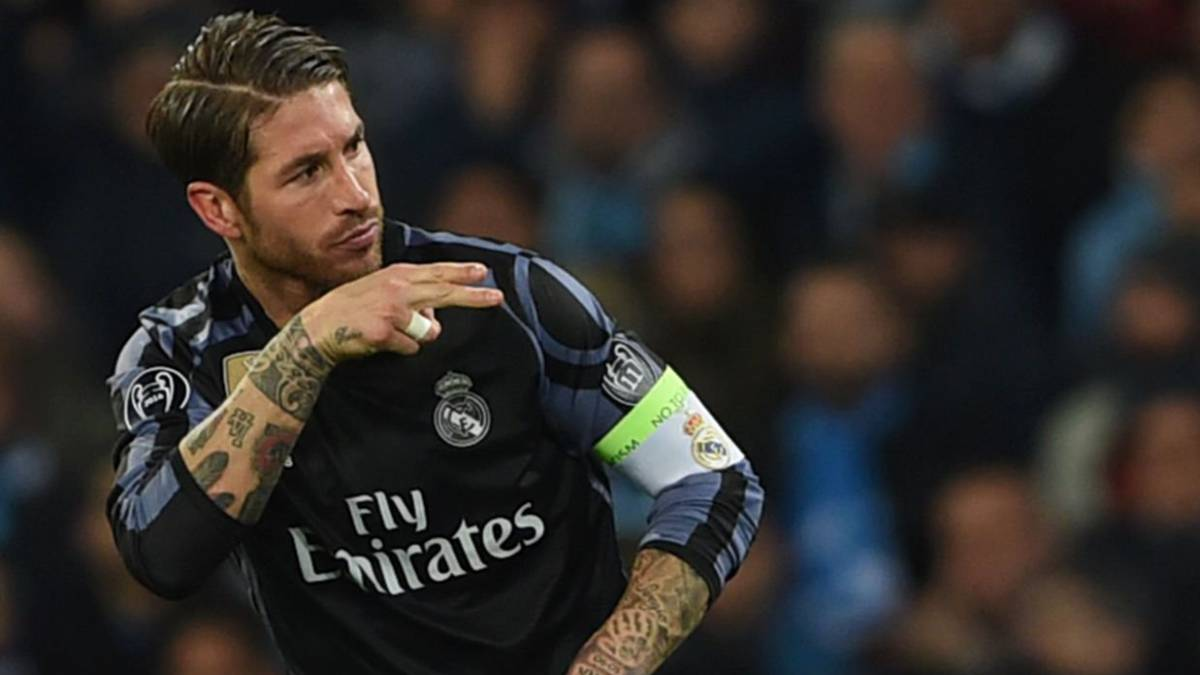 Real Madrid's defender Sergio Ramos celebrates after scoring during the UEFA Champions League football match SSC Napoli vs Real Madrid on March 7, 2017 at the San Paolo stadium in Naples.