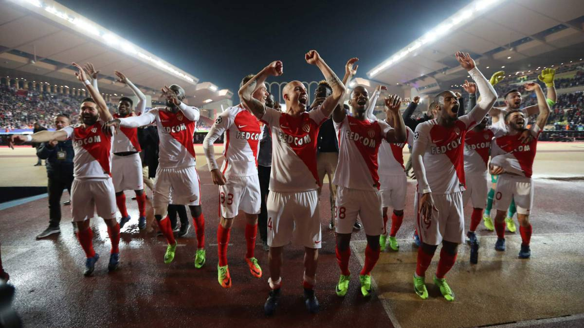 Monaco's players celebrate at the end of the UEFA Champions League round of 16 football match between Monaco and Manchester City at the Stade Louis II in Monaco on March 15, 2017.