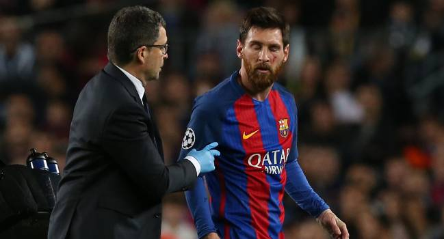 Barcelona's Lionel Messi receives medical attention for a facial injury.