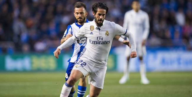 Isco of Real Madrid duels for the ball with Emre colak of RC Deportivo La Coruna during the La Liga match between RC Deportivo La Coruna and Real Madrid at Riazor Stadium on April 26, 2017 in La Coruna, Spain.
