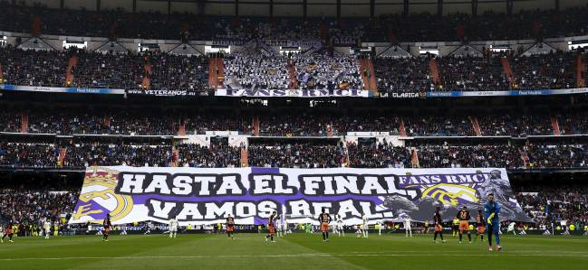Real Madrid fans cheer their team prior to start the La Liga match between Real Madrid CF and Valencia CF at Estadio Santiago Bernabeu on April 29, 2017 in Madrid, Spain.