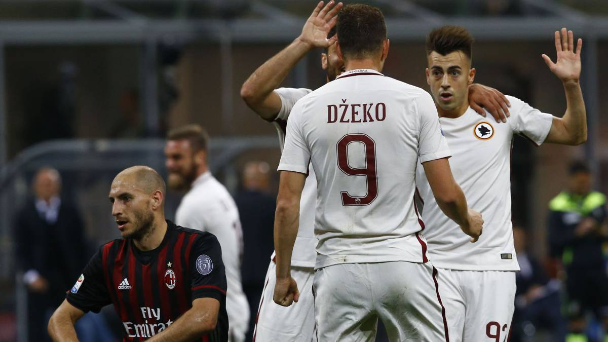AS Roma's Stephan El Shaarawy celebrates with teammates after scoring against AC Milan.