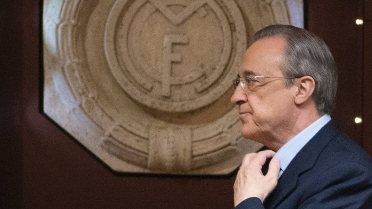 This file photo taken on November 29, 2016 shows Real Madrid's President Florentino Perez arriving for an AFP interview in the trophy room of the Santiago Bernabeu stadium in Madrid. Florentino Perez will remain as president of Real Madrid until 2021 after no other candidates ran against him, the Spanish and European champions announced.
