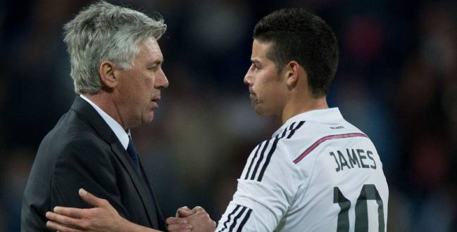Head coach Carlo Ancelotti (L) of Real Madrid CF shakes hands with his player James Rodriguez (R) after the La Liga match between Real Madrid CF and Malaga CF at Estadio Santiago Bernabeu on April 18, 2015 in Madrid, Spain.