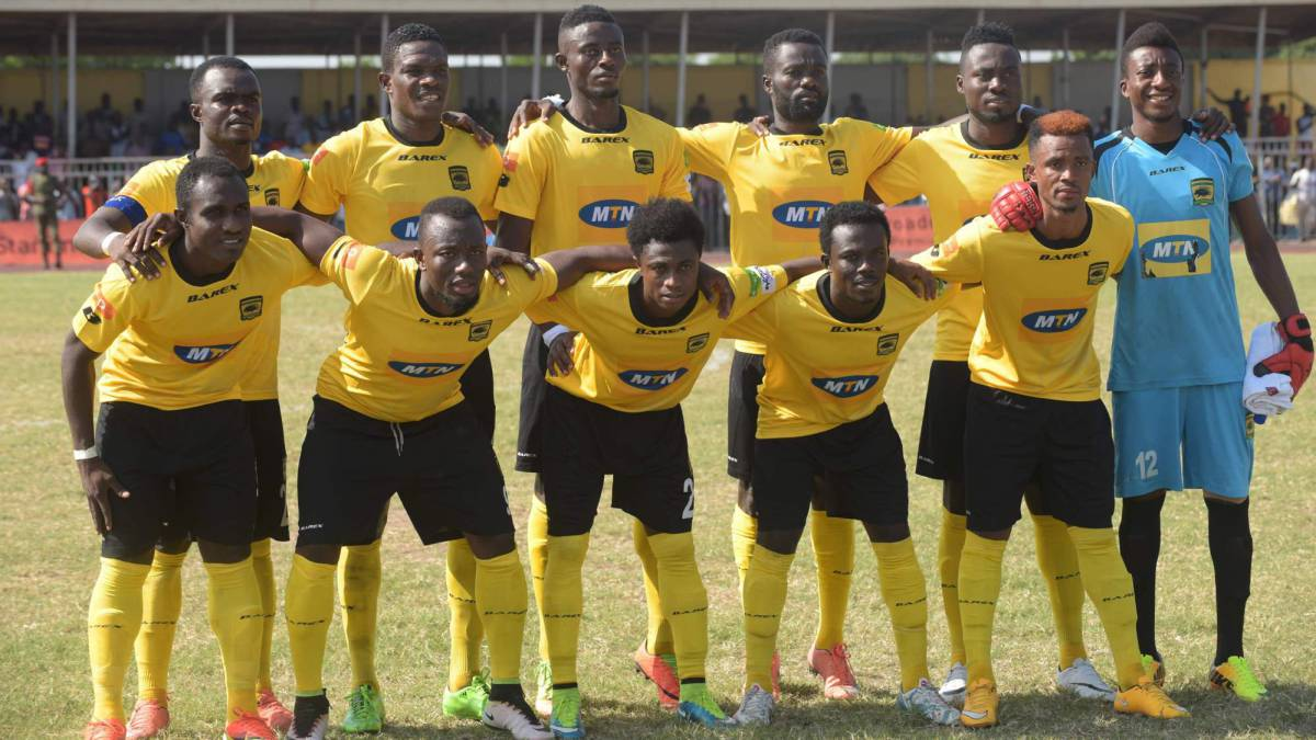 Players of Kumasi Asante Kotoko Football Club pose for a group photograph before a league match against Inter Allies Football Club at the El Wak stadium in Accra, on July 12, 2017. One person was killed and dozens more injured when a bus conveying Ghana's Asante Kotoko football team rammed into a stationary truck after a match, police said on July 13. The Premier League side was heading back to the central city of Kumasi after a 1-0 defeat to Inter Allies in the capital.