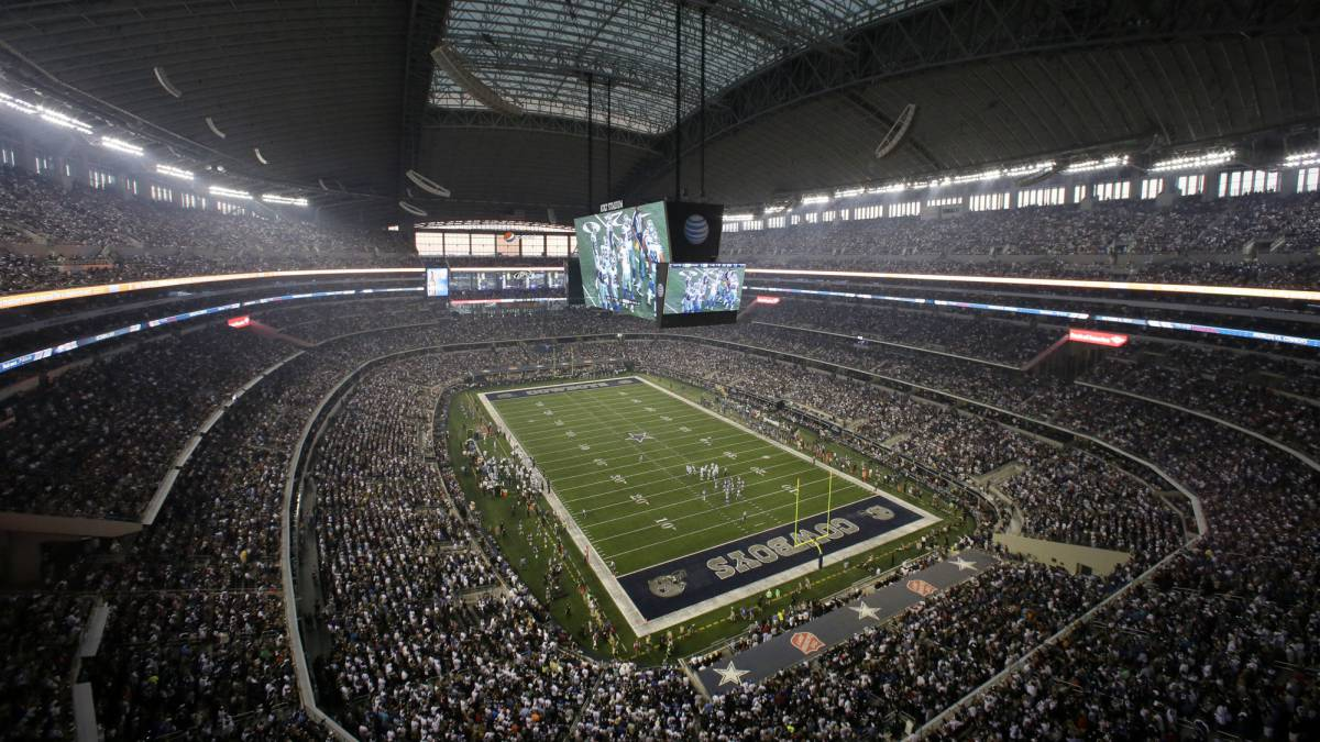 In this Sept. 8, 2013, file photo, fans watch at the start of an NFL football game between the New York Giants and Dallas Cowboys, in Arlington, Texas. The owboys are worth $4.2 billion, making them the most valuable sports franchise for the second straight year, according to Forbes.