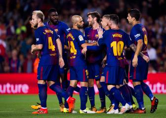 Barça sink Málaga with a hint of controversy