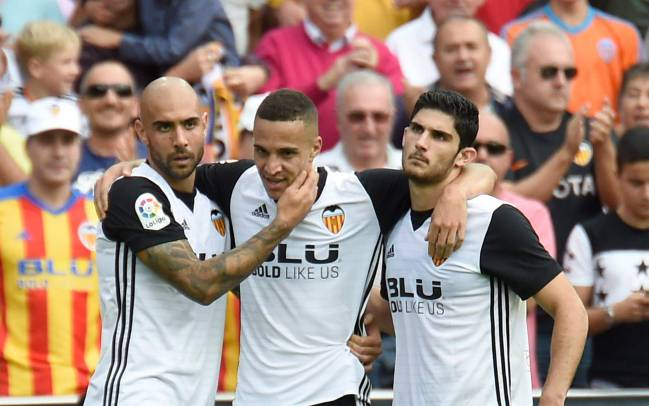 On form | Zaza, Rodrigo Moreno and Guedes celebrate another Valencia goal.