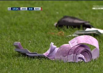 Bayern Munich fans chuck 500 euro notes on pitch in protest