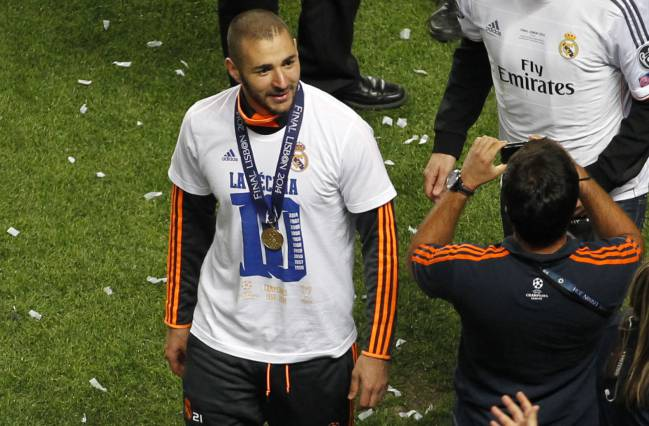 Benzema celebrates Real Madrid's 10th European Cup win in 2014.