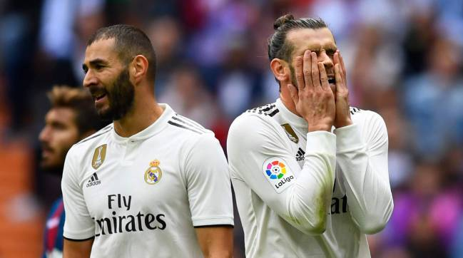 Karim Benzema (left) and Gareth Bale rue a missed opportunity on Saturday.