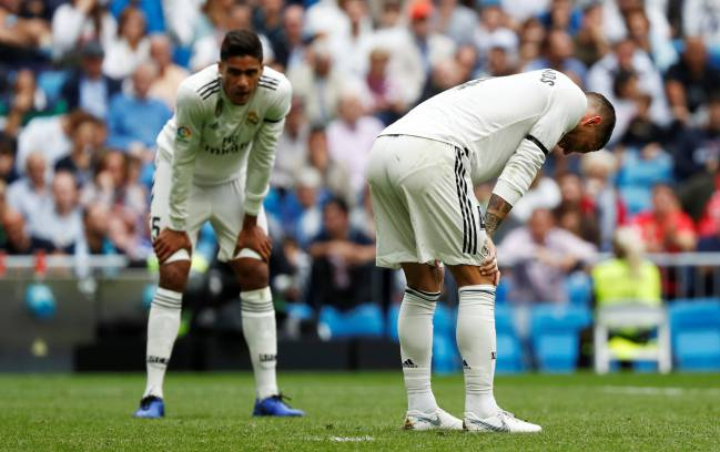 Raphael Varane (left) and Sergio Ramos look dejected as Real fall to a 2-1 defeat.