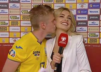 Zinchenko plants kiss on Ukrainian reporter
