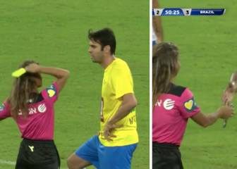 Kaká gets a card as ref lets down her guard to snap selfie