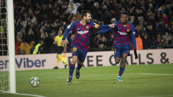 Messsi celebra un gol con Ansu Fati