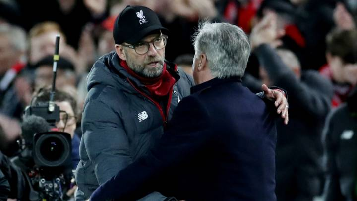 Soccer Football - FA Cup - Third Round - Liverpool v Everton - Anfield, Liverpool, Britain - January 5, 2020  Liverpool manager Juergen Klopp hugs Everton manager Carlo Ancelotti after the match  Action Images via Reuters/Carl Recine