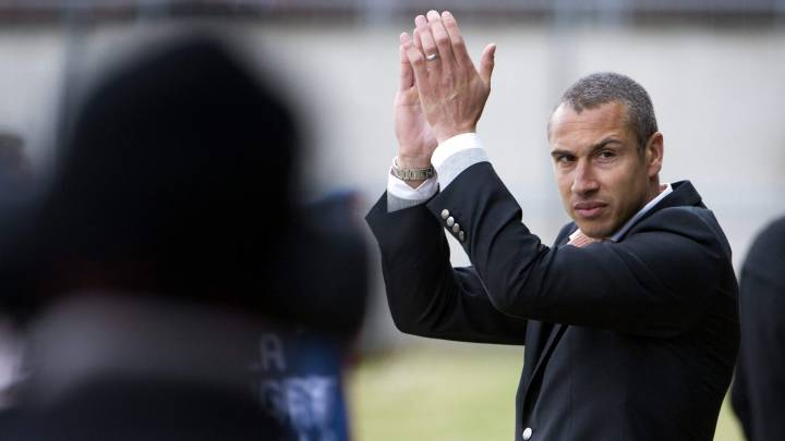 Henrik Larsson applauds during the first game of the season for his team Landskrona Bois, against Degerfors, in the Swedish second football league, Superettan, in Landskrona April 10 2010. Larsson played for teams such as Glasgow Celtics and Barcelona before becoming the coach of Landskrona Bois from this season. REUTERS/Scanpix Sweden (SWEDEN - Tags: SPORT SOCCER) NO COMMERCIAL OR BOOK SALES. SWEDEN OUT. NO COMMERCIAL OR EDITORIAL SALES IN SWEDEN