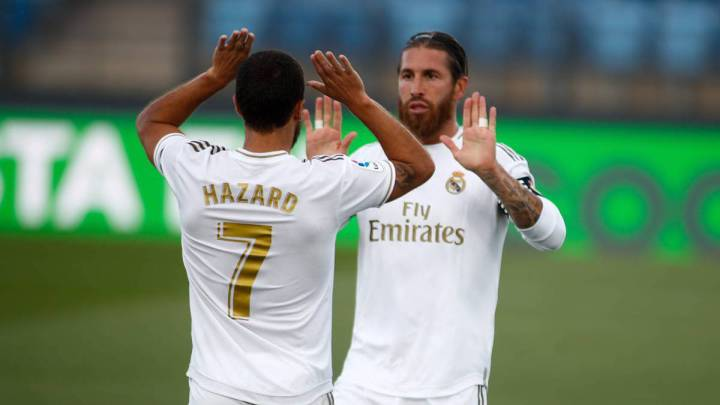 Eden Hazar and Sergio Ramos high five while in action for Real Madrid
