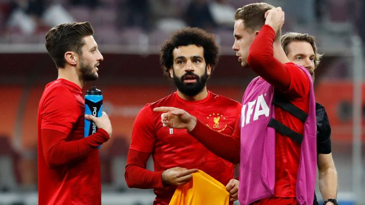 Soccer Football - Club World Cup - Semi Final - Monterrey v Liverpool - Khalifa International Stadium, Doha, Qatar - December 18, 2019  Liverpool's Adam Lallana , Mohamed Salah and Jordan Henderson during the warm up before the match    REUTERS/Corinna Kern