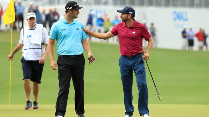 Sergio Garcia y Jon Rahm hablan durante el World Golf Championships-Dell Technologies Match Play en el Austin Country Club.