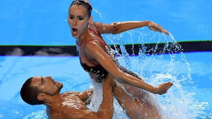 Spain\'s Berta Ferreras Sanz and Spain\'s Pau Ribes compete in the Mixed duet Free Routine preliminary during the synchronised swimming competition at the 2017 FINA World Championships in Budapest, on July 22, 2017.