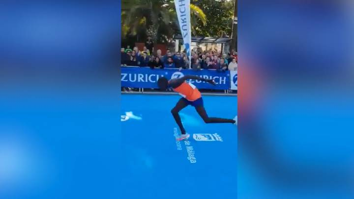 Marathon runner hits wall yards from finish, crawls over line - and drops from second to fourth