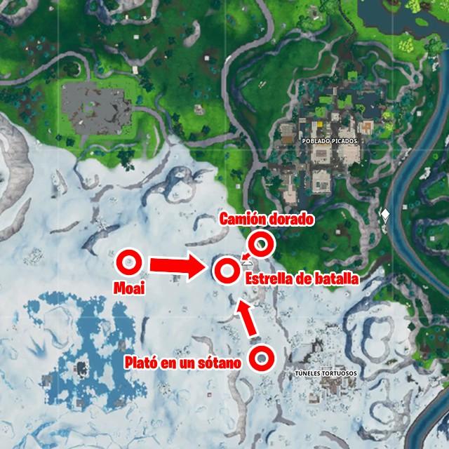 fortnite battle royale temporada 10 temporada x desafios taquillazo desafio busca entre una videocamara de sotano una cabeza de piedra nevada y un gran y llamativo trailer de oro mapa