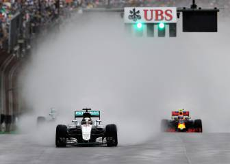 Hamilton sets up title decider with win in wet Brazil