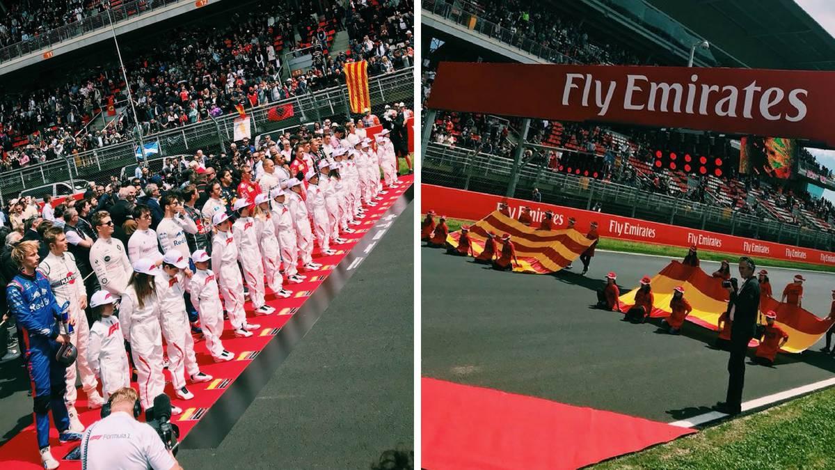Los pilotos de F1 escuchan los himnos de España y Cataluña durante el GP de España.