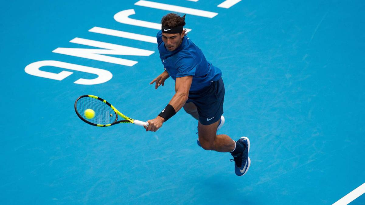 Nadal defeats Isner to set up semi-final against Dimitrov