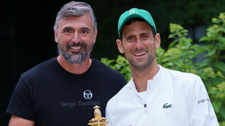 Novak Djokovic and Goran Ivanisevic pose with the 2021 Wimbledon Champions Trophy.