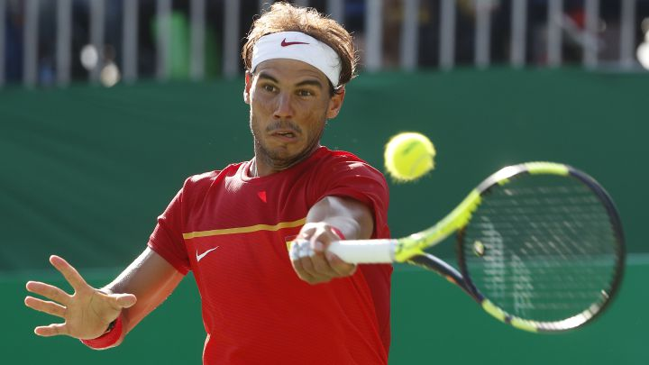 Rafa Nadal returns a ball during his match against Kei Nishikori for the individual bronze medal at the 2016 Rio Olympics.