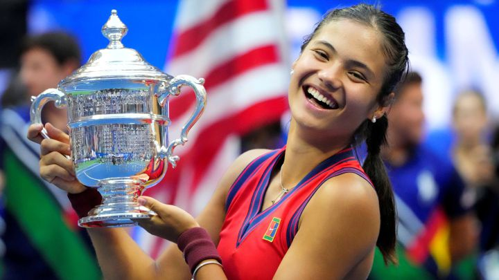 Emma Raducanu poses with the 2021 US Open Women's Champion Trophy at the USTA Billie Jean King National Tennis Center.
