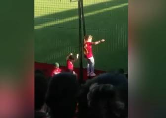 Small girl leads Newell's Old Boys fan chants from the stands