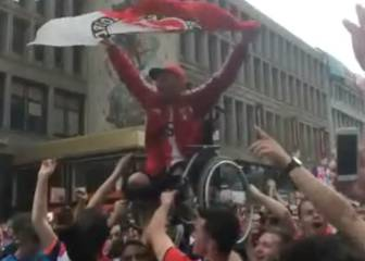 Wheelchair-bound Feyenoord fan carried aloft in title party
