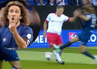 Have a word ref! Puyol goes in high on Phil Neville