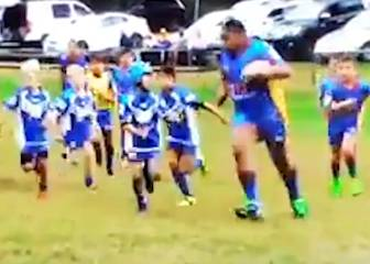 Seven-year-old man mountain ploughs through opponents