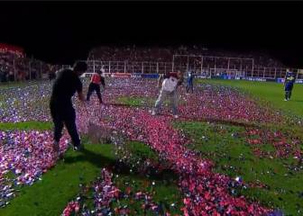 Boca match delayed while confetti-strewn pitch is cleared