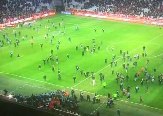 Lille fans invade pitch to attack players