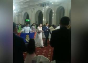 Chinese bride and groom enter wedding reception to rousing sounds of Real Madrid anthem